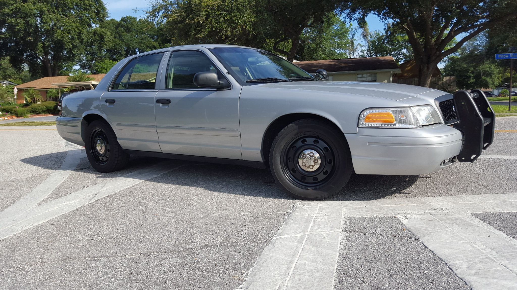 silver unmarked crown victoria p police